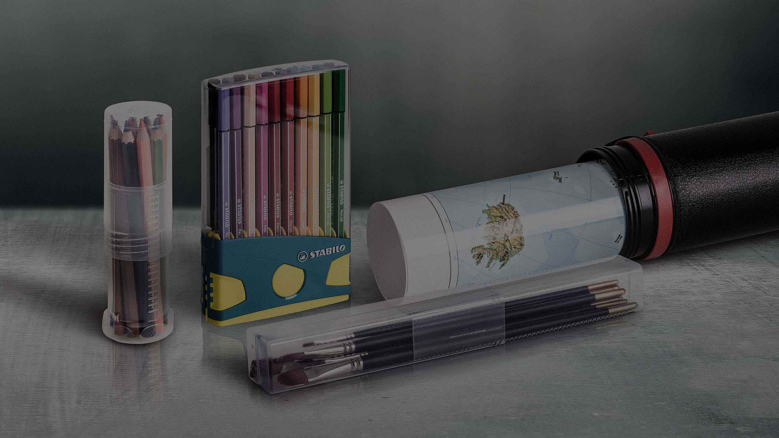 A selection of plastic packaging for stationery and art supplies.
